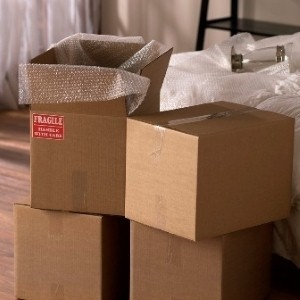 Packing items with care ensures a safe delivery when moving.