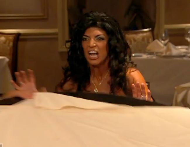 Teresa Guidice flips over a table