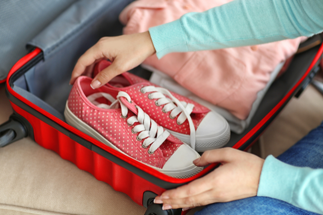 woman-packing-shoes.jpg